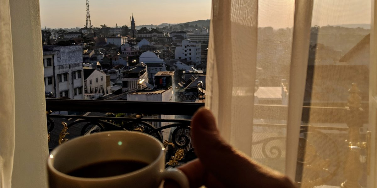 Cup of coffee on a balcony in the morning